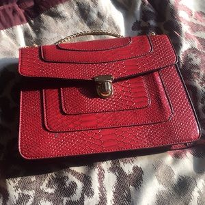 Red skin purse with gold chain